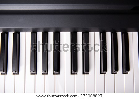 Piano keys viewed from above - stock photo