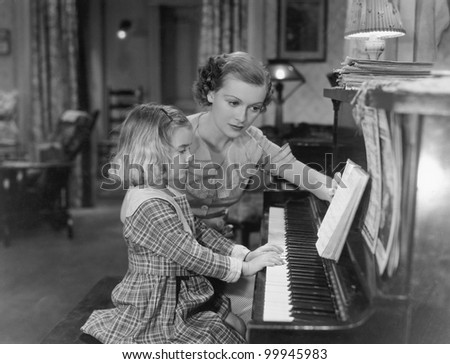 Piano lesson - stock photo