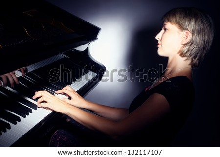 Piano playing pianist player. Woman with classical musical instrument grand piano - stock photo
