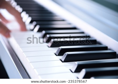 piano playing view from right angle - stock photo