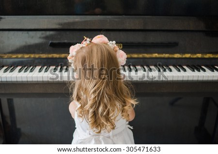 Piano school for little girl - stock photo