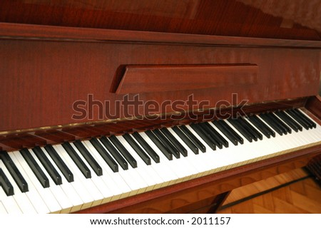 Piano with polished wooden finishing - stock photo