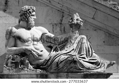 Piazza del Campidoglio - Statue del Tevere in Rome, Italy - stock photo