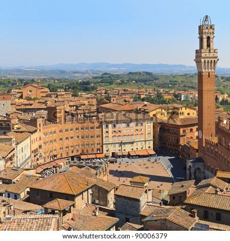 Piazza del Campo with Palazzo Pubblico, Siena, Italy - stock photo