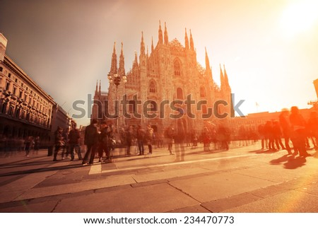 Piazza del Duomo of Milan, using nd filter to allow longer exposures. The photo has been taken during iStockalypse 2011 in Milan - stock photo