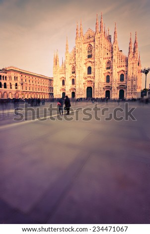 Piazza del Duomo of Milan, using nd filter to allow longer exposures.  Tilt shift effect. - stock photo