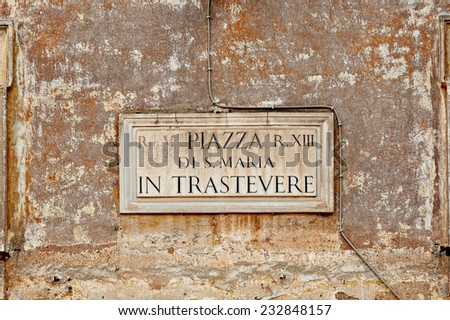 Piazza di S. Maria in Trastevere  sign on a wall at Piazza di Santa Maria in Trastevere, Rome Italy - stock photo