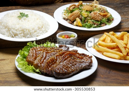 picanha potato with rice and beans drover - stock photo