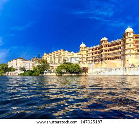 Pichola lake in India Udaipur Rajasthan. City buildings reflection on water - stock photo