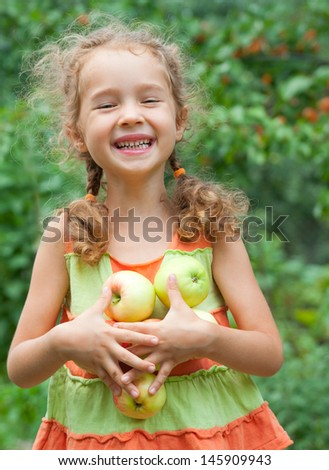 Picking apples. Happy girl with apples  - stock photo