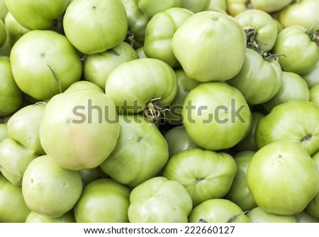 Pickle green tomatoes in a supermarket - stock photo