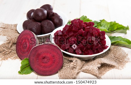 Pickled Beetroot on wooden background - stock photo