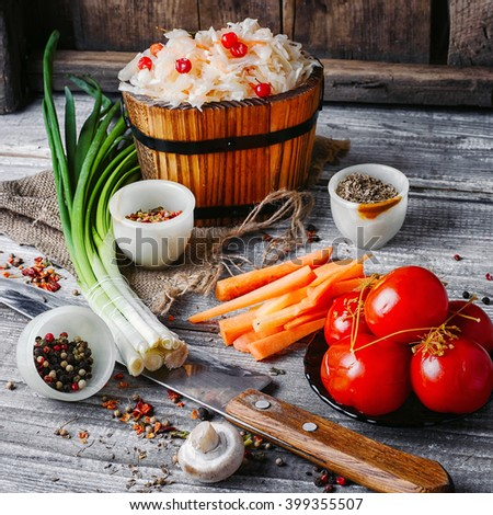 pickled cabbage and salted tomatoes in a rustic style - stock photo