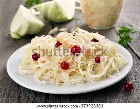 Pickled cabbage (sauerkraut) on country table - stock photo