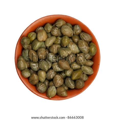 Pickled capers in a clay cup, isolated, white background - stock photo