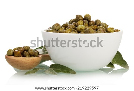 Pickled capers in spoon and bowl isolated on white background - stock photo