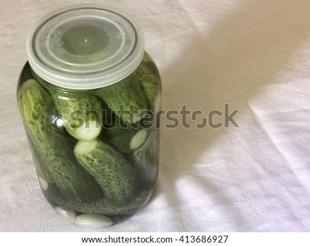 Pickled cucumbers. Prepare for canning in big glass jar - stock photo