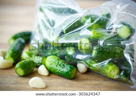 pickled cucumbers with spices in a vacuum package - stock photo
