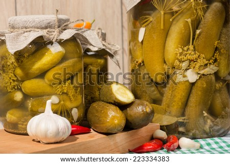 pickled gherkins in jars of home canning - stock photo