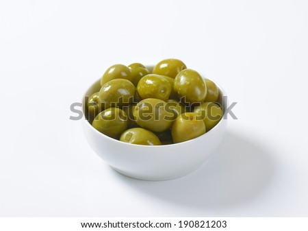 pickled green olives without stones, served in the bowl - stock photo