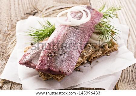 pickled herring fillet - stock photo