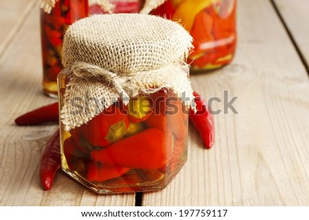 Pickled red peppers - stock photo