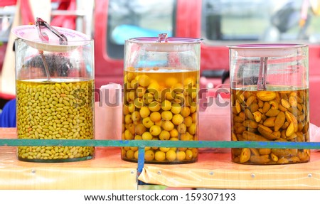 Pickled Tamarind and Grapes fruits in Bottle Glass. - stock photo