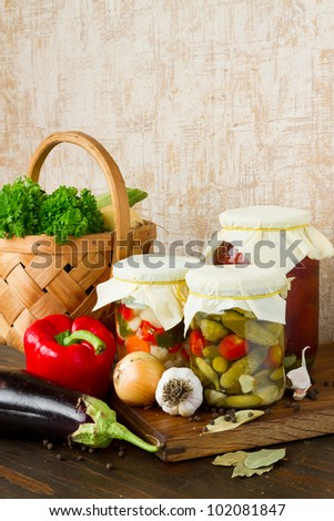 pickled vegetables on kitchen table - stock photo