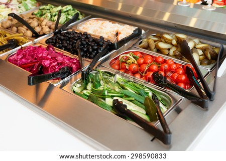 Pickled vegetables on self service restaurant counter - stock photo