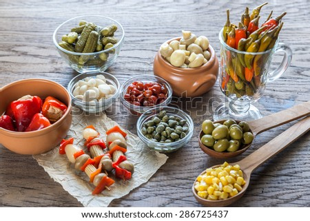 Pickled vegetables on the wooden background - stock photo