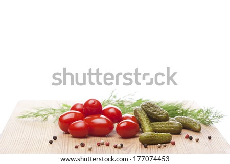 Pickled vegetables, tomatoes, cucumbers, pickles, spice - stock photo
