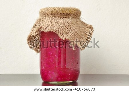 Pickles from sauerkraut and red beet the glass, front horizontal view. Healthy pickled vegetable. - stock photo