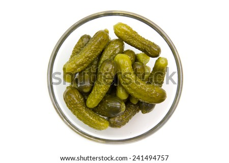 pickles on bowl on white background seen from above - stock photo