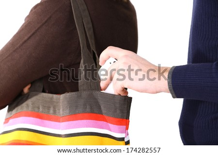 Pickpocket are stealing mobile phone from bag, close up, isolated on white - stock photo