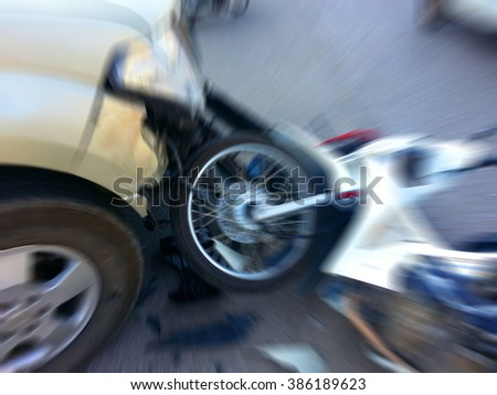 Pickup crashes motorcycle on the road - stock photo