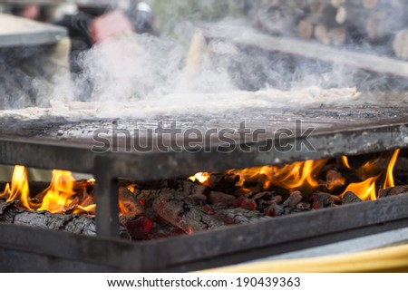 picnic, barbecue with sausages and lamb in a medieval fair, Spain - stock photo