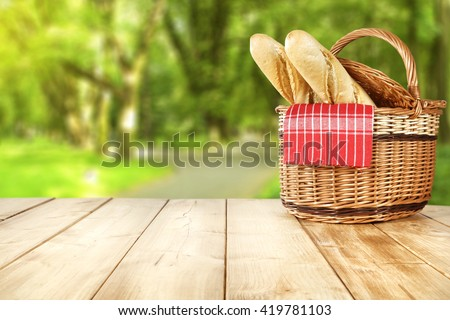 picnic basket and bread  - stock photo