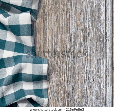 picnic cloth over old wooden table grunge background - stock photo