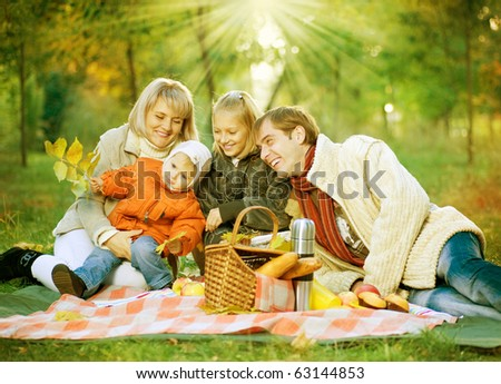 Picnic. Happy Family in Autumn Park - stock photo
