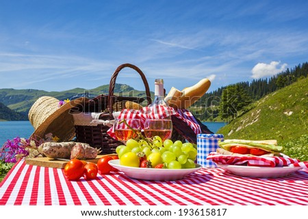 Picnic in french alpine mountains with lake on background - stock photo
