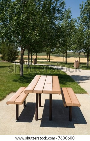 Picnic table and walking path at rest area found along an interstate highway in the USA - stock photo