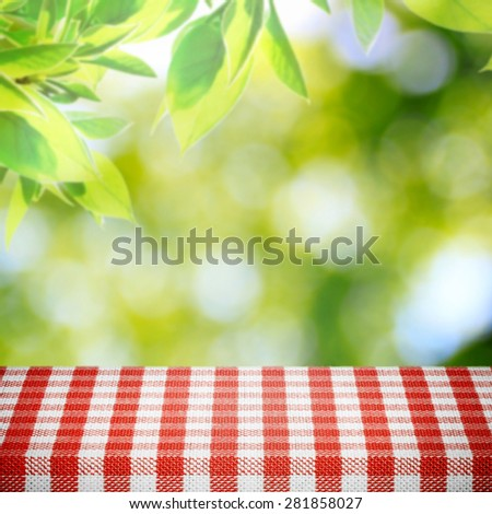 Picnic table in summer background - stock photo