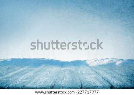 Picnic table or wooden path in sunny winter day - stock photo