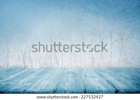 Picnic table or wooden path in winter snowing day - stock photo