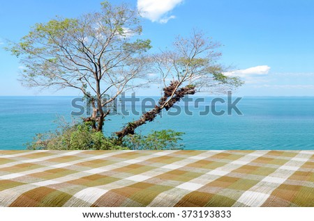 Picnic Table with Bright Sky and South Sea View on the Sunny Day. - stock photo