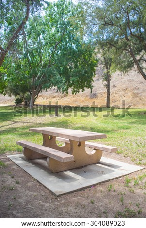 Picnic tables in the park at Val Verde California. - stock photo