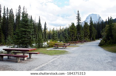 Picnic tables over looking river at  Yoho National Park, British Columbia, Canada - stock photo