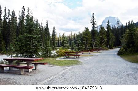 Picnic tables over looking river at  Yoho National Park, British Columbia, Canada - stock photo