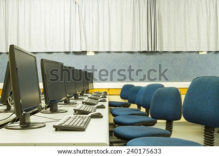 Picture a classroom equipped with personal computers with LCD monitors - stock photo