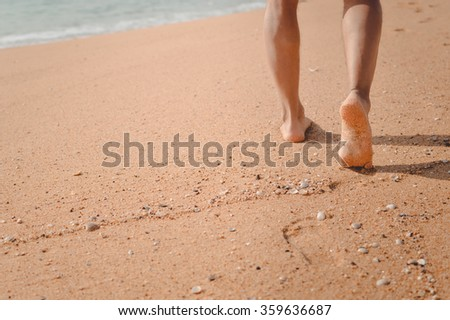 Picture closeup of man's feet at the shore. Relaxing vacation concept - stock photo